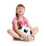 Crying girl with soccer ball isolated on white