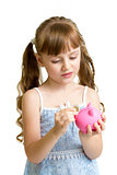 Girl putting coin into piggy bank isolated