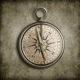 old compass over vintage background