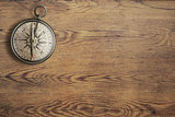 old compass on vintage wooden table top view