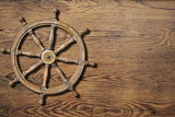Steering wheel over wood background