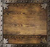 medieval metal frame over old wooden background
