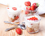 serving of yogurt with granola and strawberries
