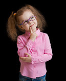 Adorable child girl in eyeglasses isolated on black