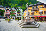 Religious monument with typical colorful houses in Hallstatt