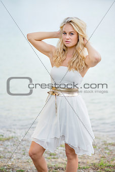 Blond woman in white dress