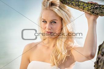 Blond woman under tree