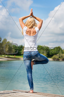 Blond woman yoga exercise