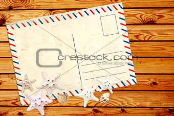 Old postcard and starfishes