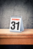 December the 31st on desk calendar at office table