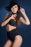 Beautiful woman in a black lingerie and big hat.