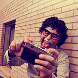hipster zombie taking a selfie, with a retro effect