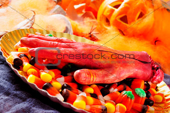 amputated hand and Halloween candies