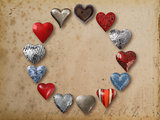 Metal heart shaped things arranged in circle