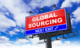 Global Sourcing Inscription on Red Billboard.