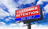 Customer Retention Inscription on Red Billboard.