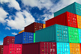 Multitiered of Colorful Containers on Sky Background.