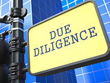 Due Diligence. Signpost on Blue Background.