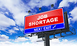 Job Shortage Inscription on Red Billboard.