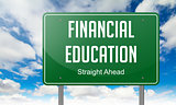 Financial Education on Highway Signpost.
