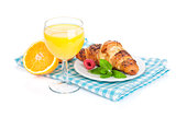 Orange juice and fresh croissant