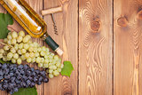 White wine bottle and bunch of grapes