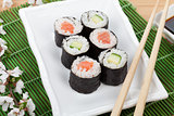 Sushi maki set with fresh sakura branch