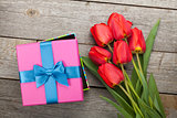 Fresh tulips and gift box