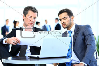 Business men discussing together in an offic