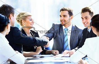 Business colleagues sitting at a table during a meeting
