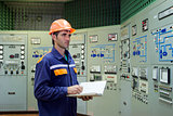 Engineer with a log on the main control panel