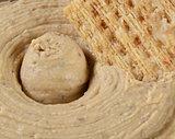 Hummus and cracker closeup