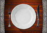 Empty Plate on Wooden Table with Cutlery