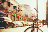 Blurred image of city street with bicycle
