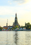 Wat Arun, the Temple of Dawn, stands on the Chao Phraya river in