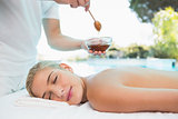 Woman receiving spa treatment with honey