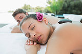Couple enjoying stone massage at health farm