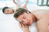 Couple enjoying massage at health farm