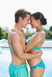 Romantic couple by swimming pool on a sunny day