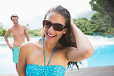 Beautiful woman by swimming pool on a sunny day