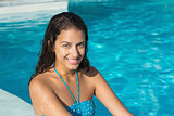 Portrait of a beautiful young woman by swimming pool