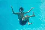 Young man wearing snorkel underwater
