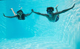 Couple wearing snorkels in swimming pool