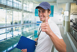 Swimming instructor smiling at camera by the pool