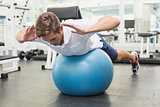 Man in plank position on exercise ball