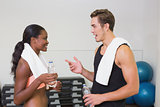 Personal trainer and client chatting