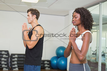 Fit couple standing with hands together