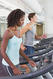 Fit people running on treadmills
