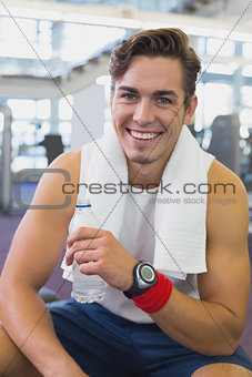 Fit man taking a break from working out