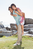 Gorgeous couple having fun by the coast